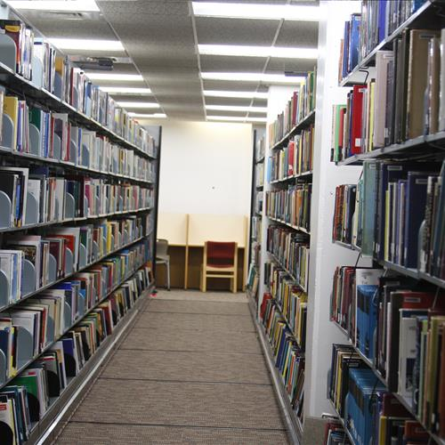 Library filing on static cantilever shelving