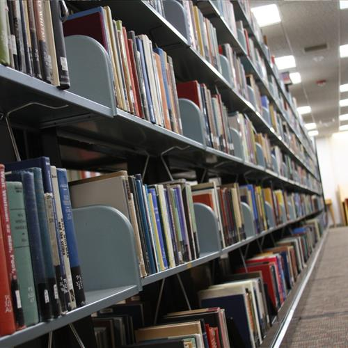 Library book storage on cantilever shelving