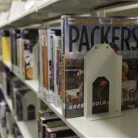 Book supports on cantilever shelving at Madison Public Library