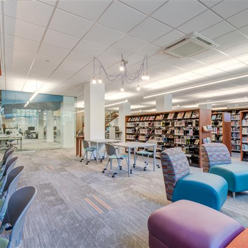 Open workspace next to library shelving at Part City Library