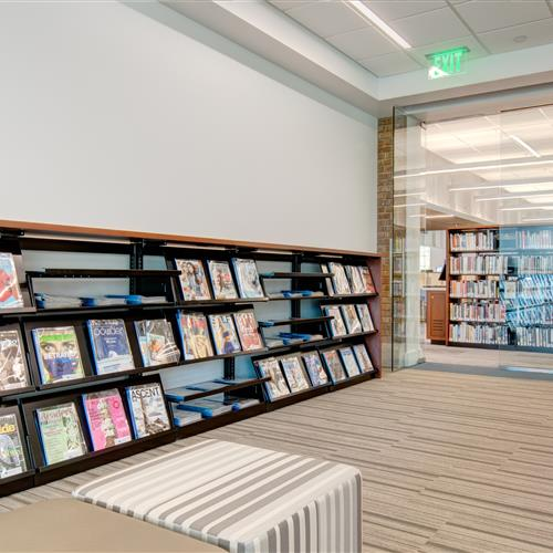 Magazines and library material on static cantilever shelving