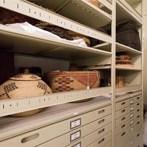Artifacts stored on 4-post shelving with bin front stops