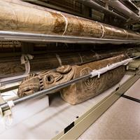 Textiles and artifacts stored on static cantilever shelving