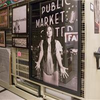Poster Art hanging on mechanical assist high-density mobile shelving