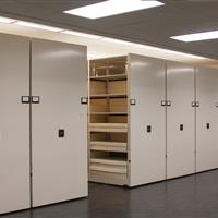 Archival storage on powered High-density mobile shelving