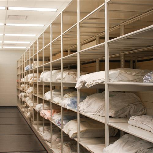 textiles stored on mobile 4-post shelving