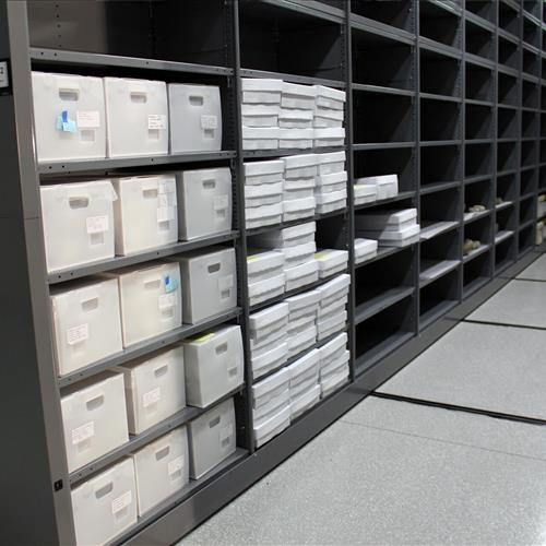 Archival storage on powered compact mobile shelving system at Western Science Center