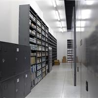 Great use of wall space with Cabinet storage and museum artifacts on static shelving
