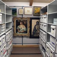 archival boxes on high-density mobile shelving and artwork hanging on art rack