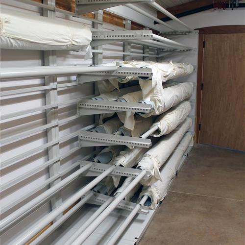 Textile storage hanging on static cantilever shelving