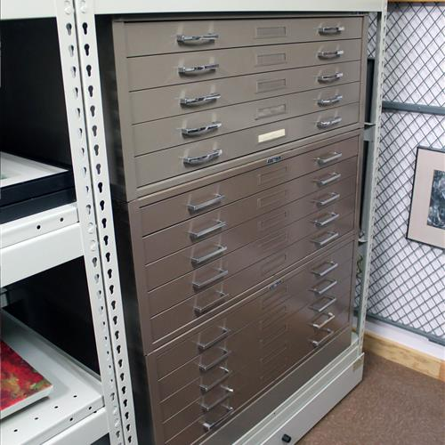 Mobile compact shelving with flat drawer file storage insert on wide span shelving