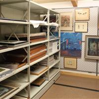 Artwork on wide span shelving and hanging art rack