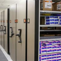 Healthcare supplies on mechanical assist mobile shelving with wire shelves