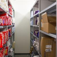 Healthcare supplies on mobile 4-post shelving