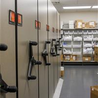 High-density mechanical assist mobile shelving and supplies on static bin shelving