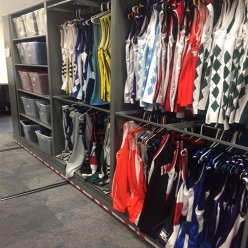 Athletic jersey storage on hanging racks and shelving