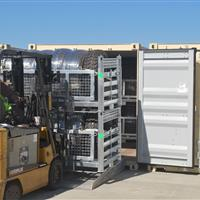 Fork truck loading Wheel Racks into storage container