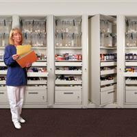 Rotary storage of pharmaceuticals secured by key