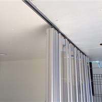 Ceiling track of accordion pocket doors at major motion studio in Los Angeles