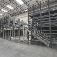 Industrial Mezzanine with 2 staircases and racking in back