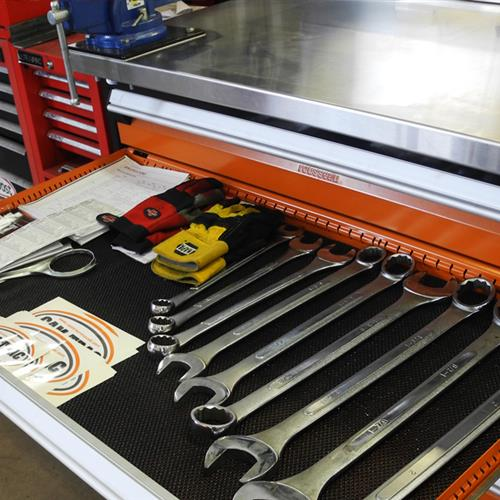 Orange modular drawers with wrenches