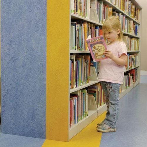 Cantilever Library Shelving with Custom End Panel Design