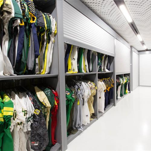 Uniform storage secured behind secured tamboured doors at University of Oregon