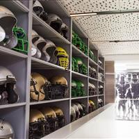 Organized football helmet storage in University of Oregon equipment room