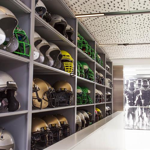 Organized football helmet storage in University of Oregon equipment room