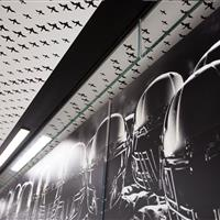 "Custom ceiling design that integrates with University of Oregon's brand ""The Ducks"""