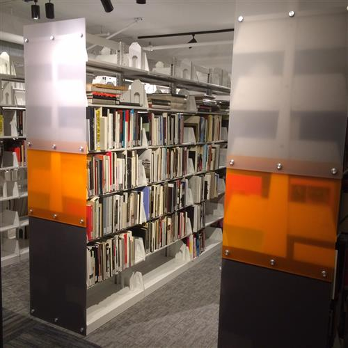 Custom acrylic end panels on cantilever shelving at UCR California Museum of Photography