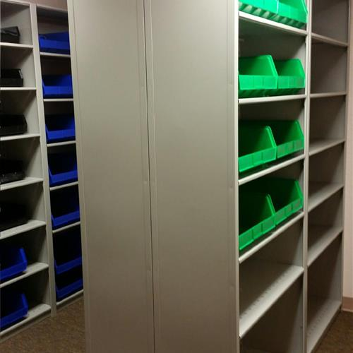 Units of Plastic bins in 4 post shelving for small item storage and organization