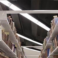 Perforated shelving allows airflow to preserve materials.jpg