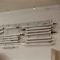 Artifact storage on perforated shelving allows air flow.JPG