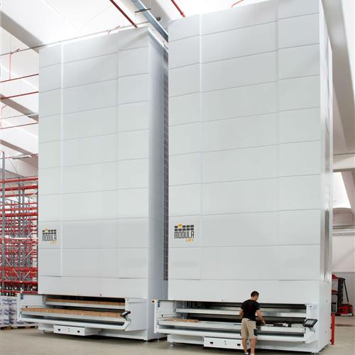 2 Modula Vertical lift units in warehouse with open space and male operator.jpg