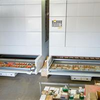 2 Modula Vertical lift units in warehouse with small parts.jpg