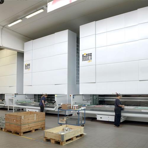 Multiple Modula Vertical lift units in warehouse with women operators.jpg