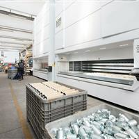 Multiple Modula Vertical lift units in warehouse with canisters.jpg
