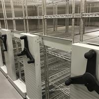 Stainless steel mechanical assist high density mobile system in refrigerated room with 4 carriages