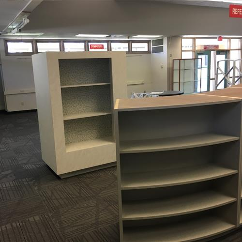 Side and inside of School library shelving unit on canisters to be mobile