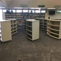 School library shelving on canisters to be mobile