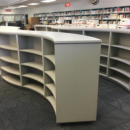 2 units of mobile shelving on canisters at School library