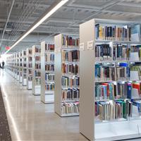 Illuminated cantilever library shelving