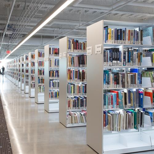 Illuminated cantilever library shelving