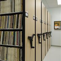 Musical recording storage compactor moveable shelves