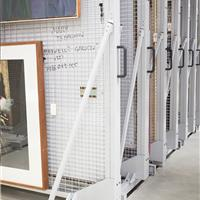 Handles allow for easy mobility on art rack storage system