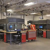 Rousseau Workstations with cabinets in warehouse