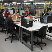 Rousseau workstations in centralized area of warehouse