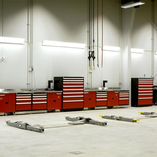 Rousseau multi-drawer cabinets in centralized area of warehouse against wall