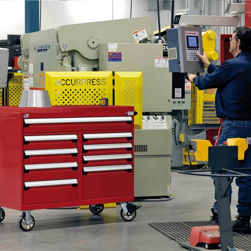 Rousseau Multi Drawer Cabinet Near Employee Working On Machinery
